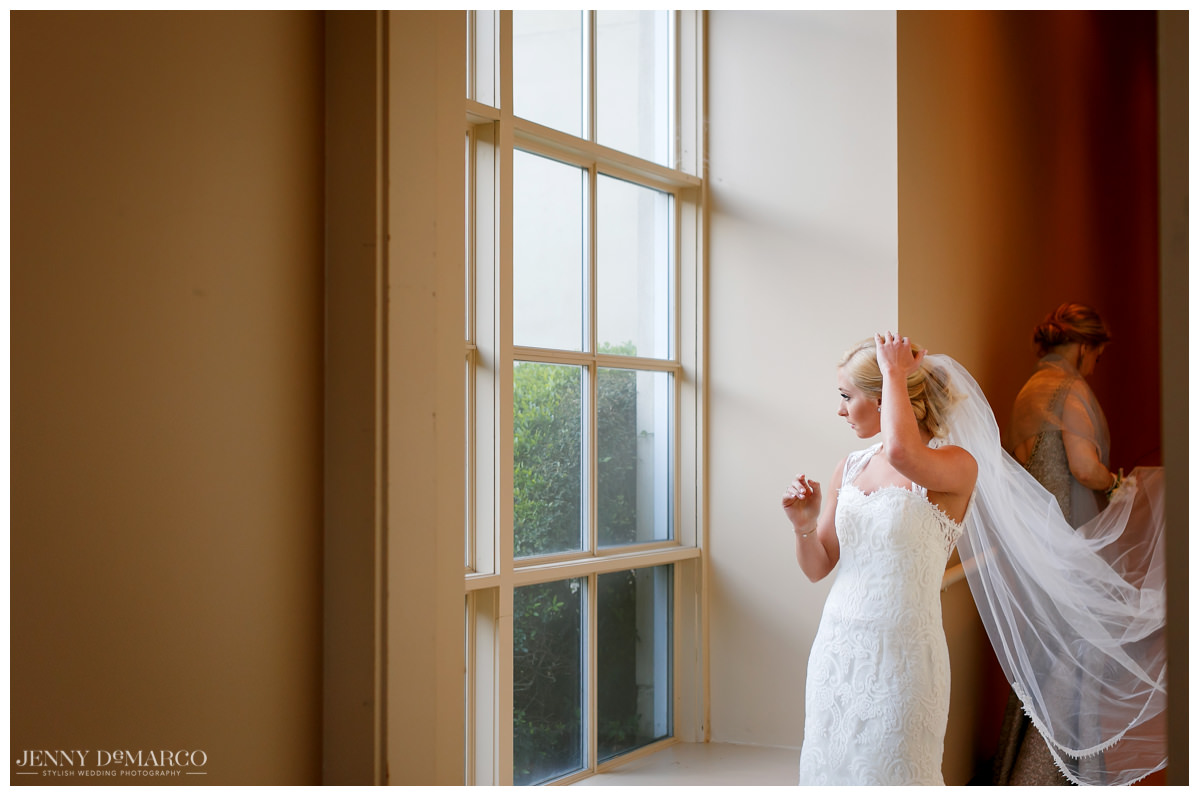 Bride looks out the window at Barton Creek in Austin, Texas