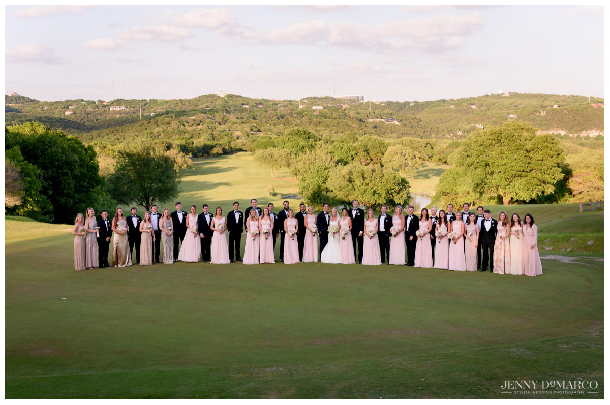 wedding party outside at barton springs pavilion in austin hill country