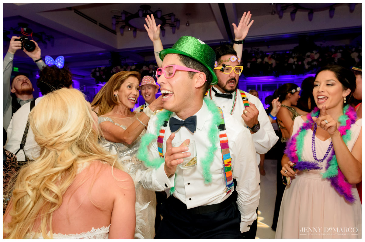 Groom dances in costume at wedding after-party