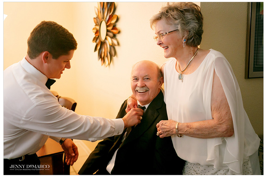 Groom spends time with his parents before the wedding