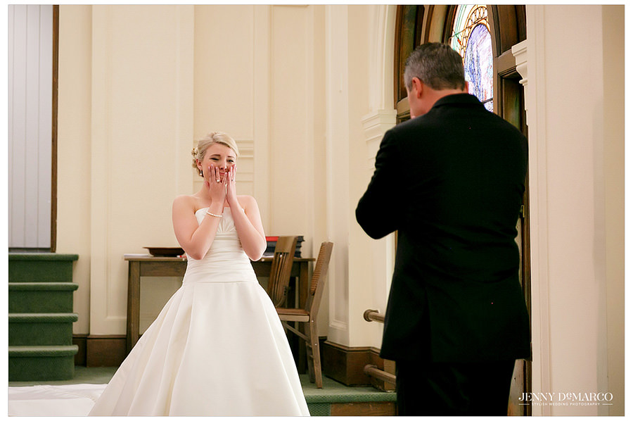Bride gets excited to show her dad her wedding dress