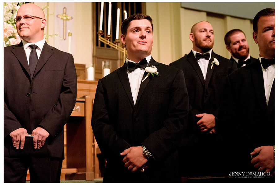 Groom as he watches his bride walk down the aisle