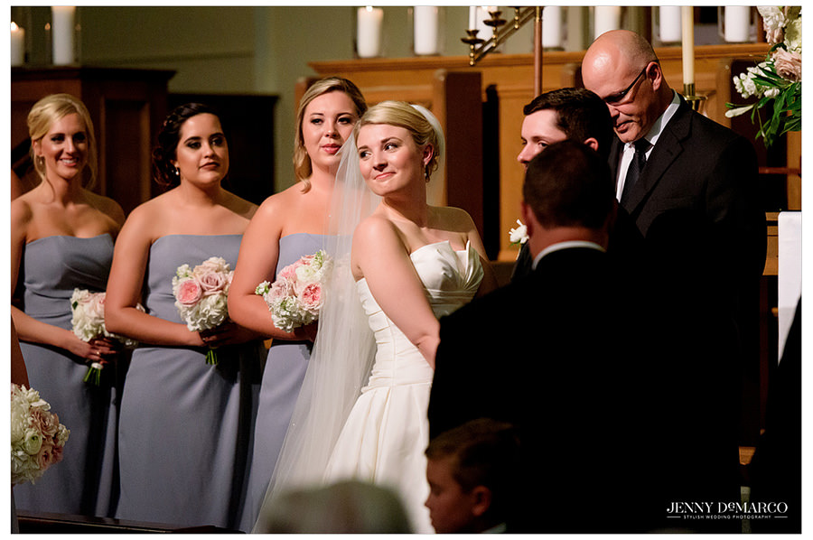 Bride laughs during the wedding ceremony