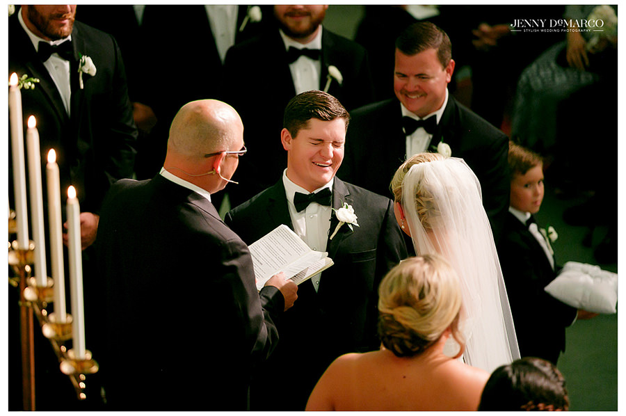 Groom laughs during the ceremony