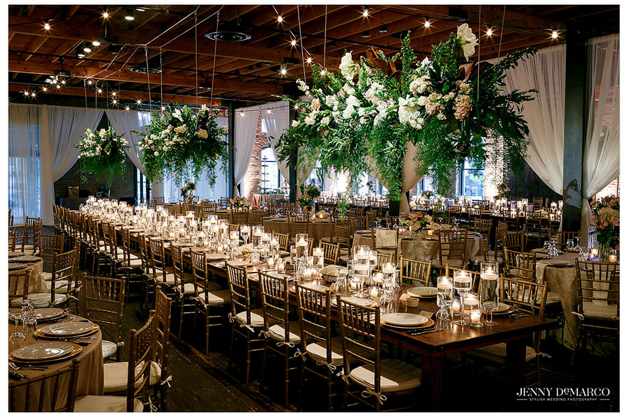 Reception hall at Brazos Hall with beautiful flower arrangements by Westbank Flower Market
