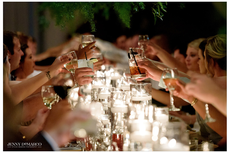 Wedding guests toast at the reception