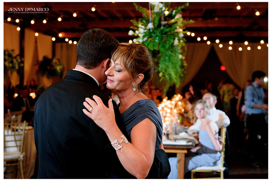 Groom dances with his mother at the wedding reception