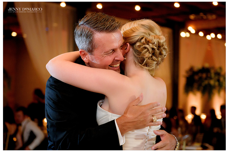 Bride dances with her father at the wedding reception