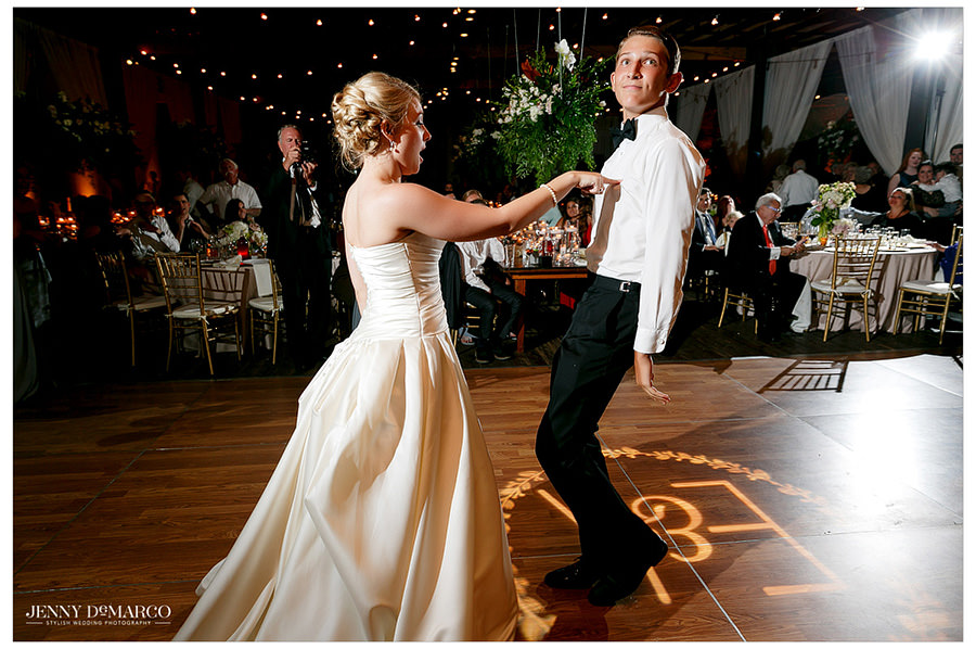 Bride dances with her brother at the wedding reception