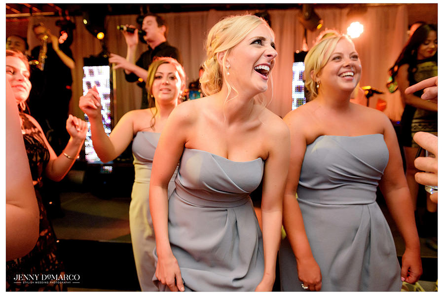 Bridesmaids laughing during wedding reception