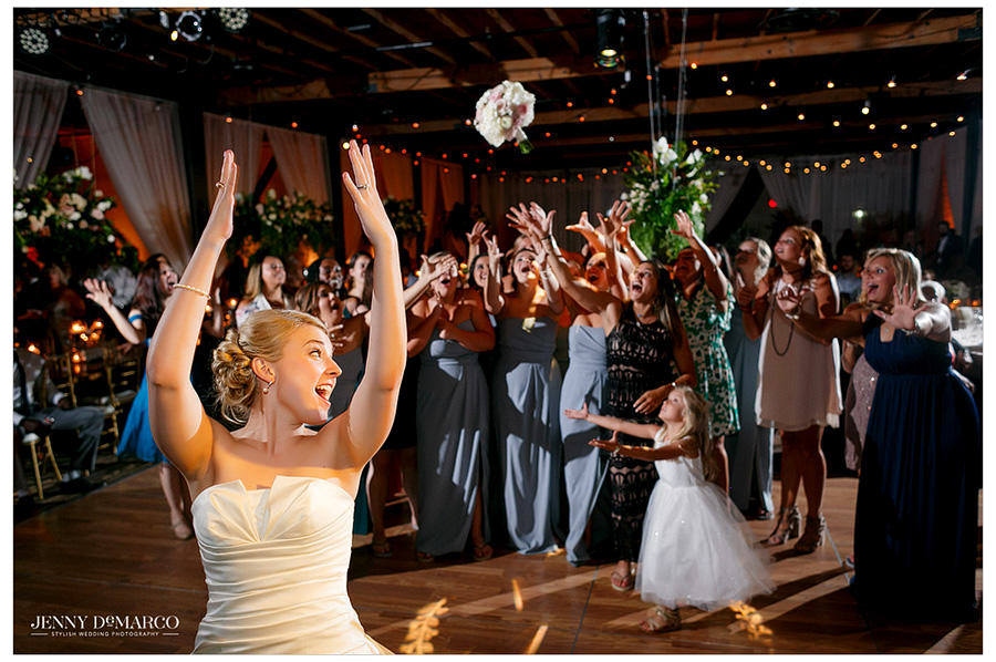 Bouquet toss with bride at wedding reception