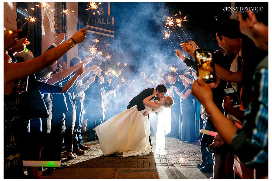 Groom and bride kiss during exit