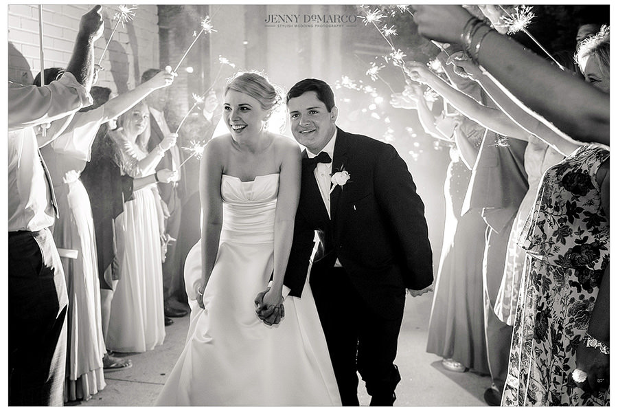 Bride and groom leaving their wedding with a ton of sparklers