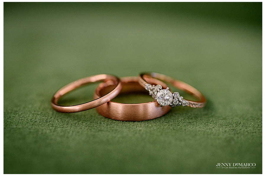 Beautiful copper wedding rings on green velvet