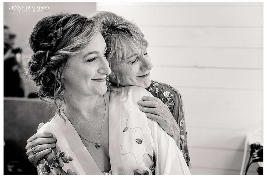 Bride and mother of the bride share a sweet moment
