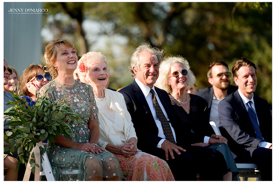 Parents of the bride watch as their daughter gets married