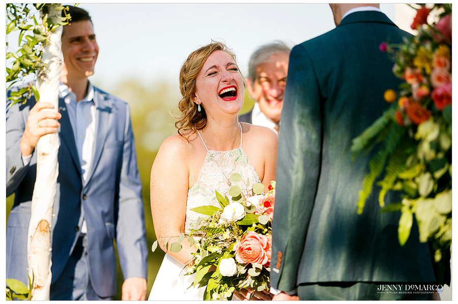 Bride laughs during her wedding ceremony
