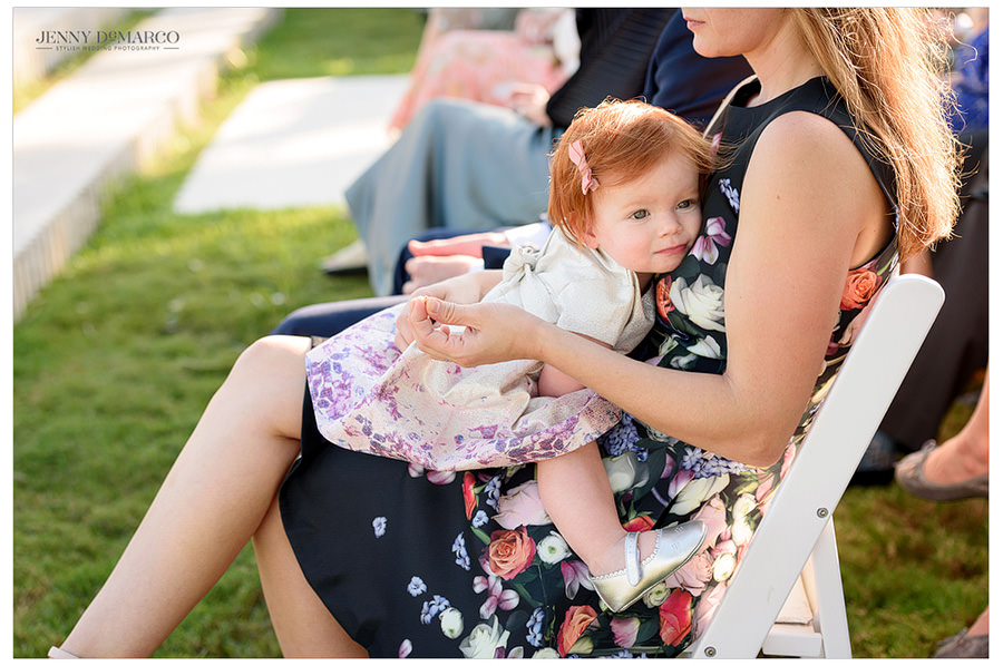 Adorable baby during wedding ceremony