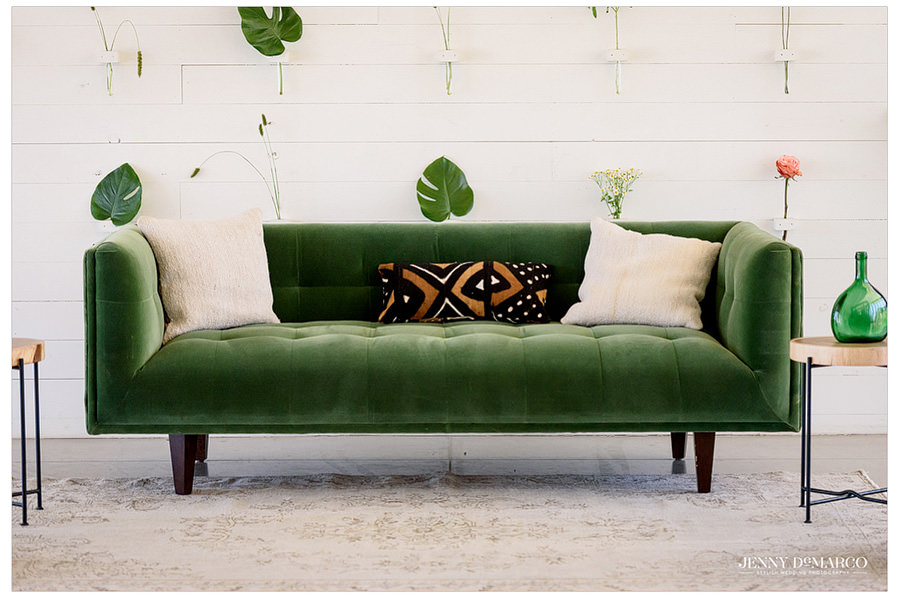 Green velvet couch for waiting area