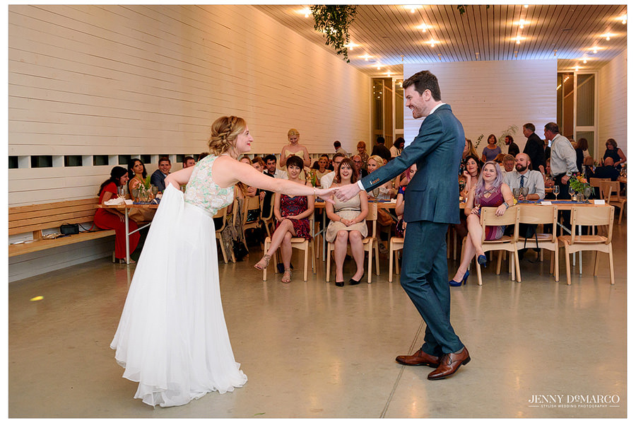 Bride and groom begin their first dance at their wedding reception