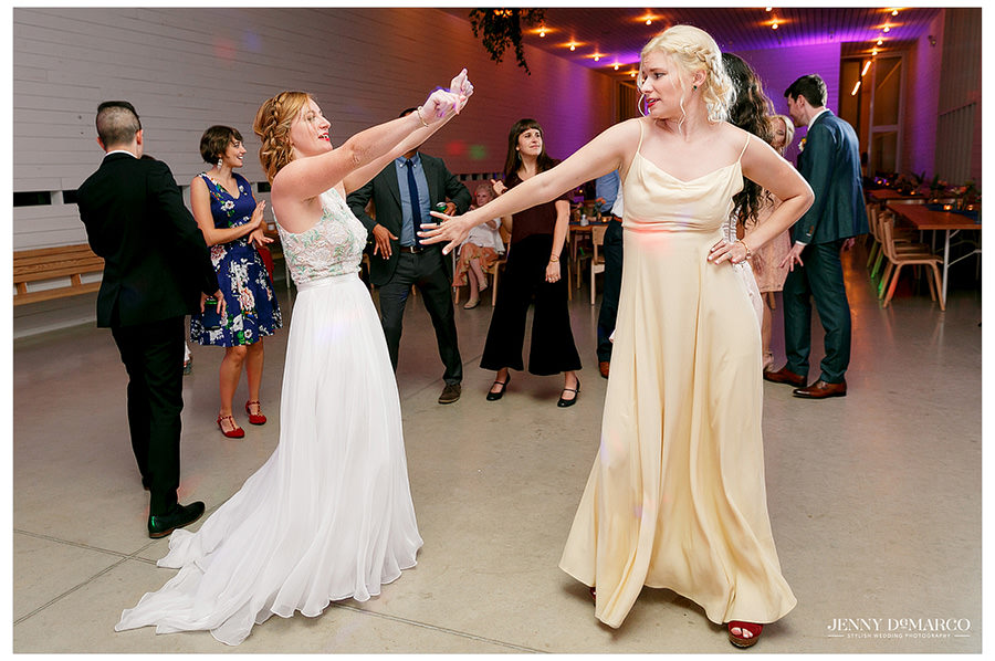 Bride and friend dancing at wedding reception