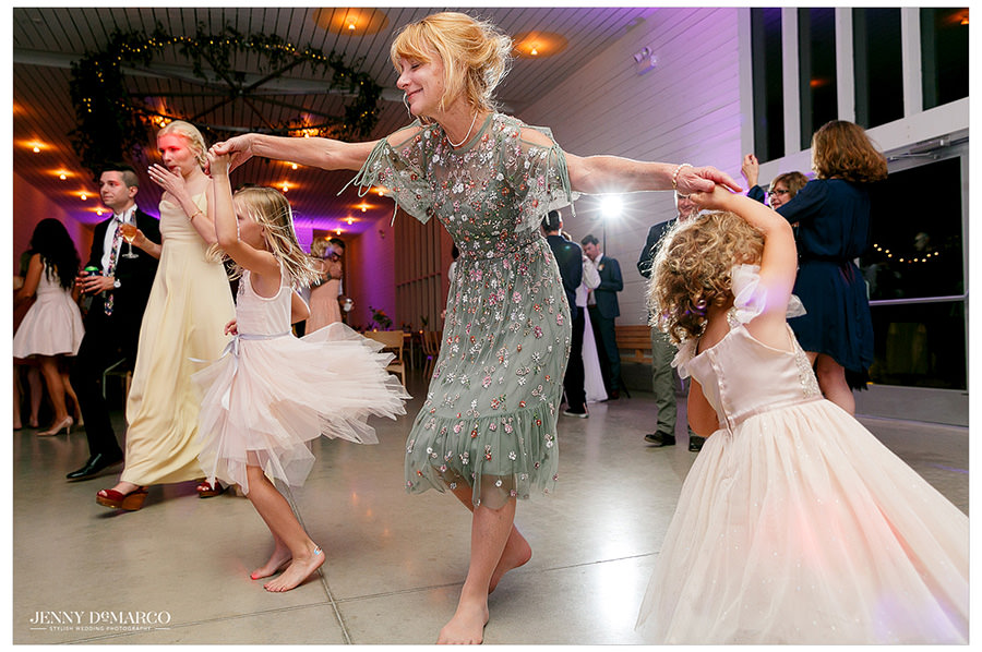 Mother of bride dancing with flower girls