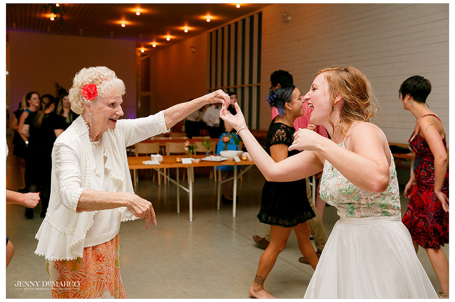 Bride dances with her grandma at the wedding reception