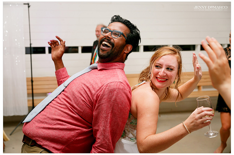 Bride dances with friend at wedding reception