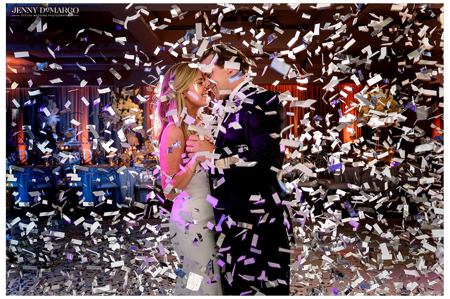 Bride and Groom final last dance at the end of the night with silver and while confetti.