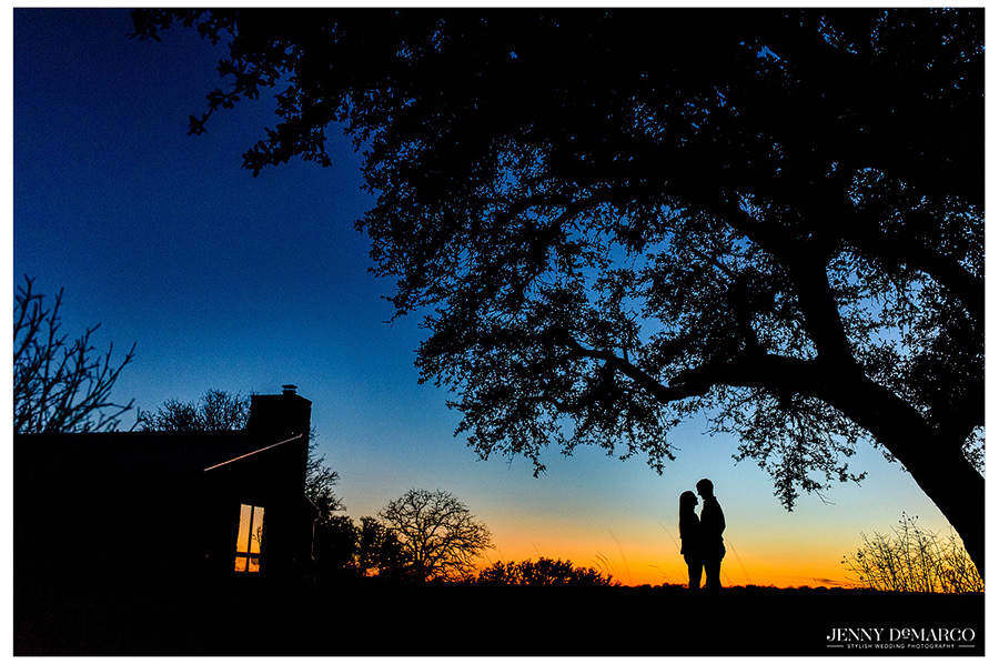 Sunset silhouette engagement of the bride and groom at their ranch.