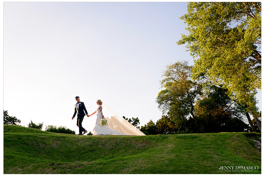 Bride and groom walking along the golf course at Barton Creek Resort