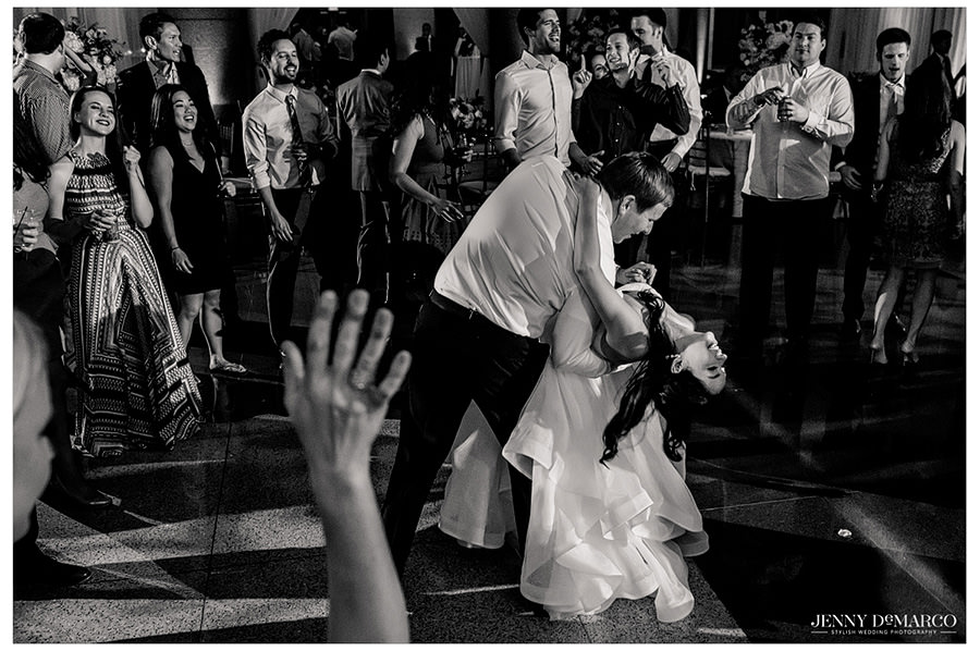 Groom dipping the bride on the dance floor.