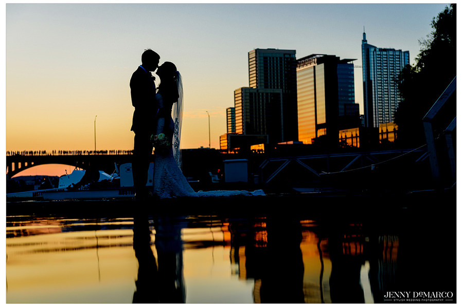 Iconic sunset silhouette with the Austin skyline and congress bridge in the background.