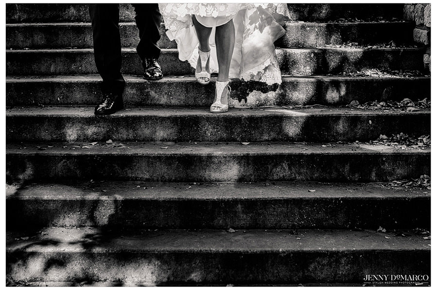 Bride stepping down with her sparkly jimmy choo shoes