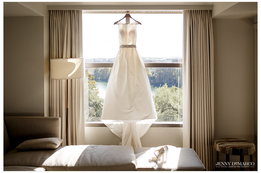 Windowsill wedding dress with belt embellishment photo.
