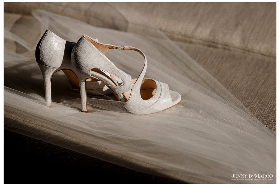Delicate wedding shoe detail on vail photo.