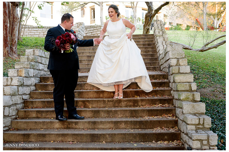 The groom helps the ride down the stairs as they make their way to the wedding.