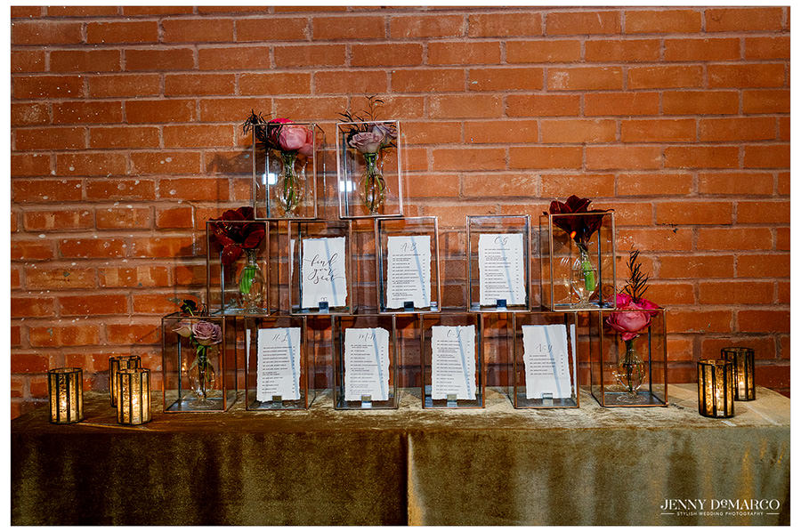 Delicate window box details and table labels for the reception. Flowers in boxes frame the guests' name tags.