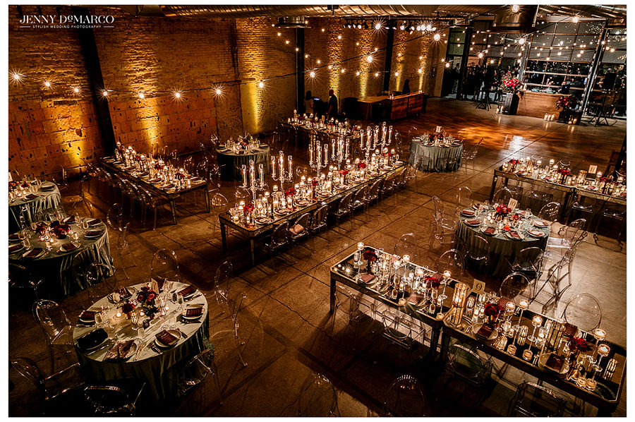 An overview image of the reception highlighting the long tables and classy setup of the reception.