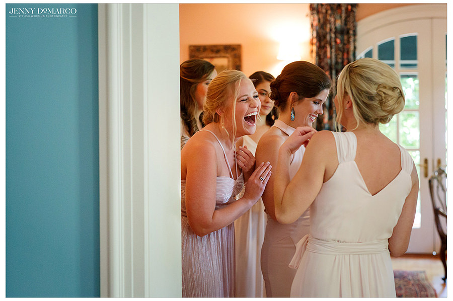 bridal party laughs as they get ready for the big day