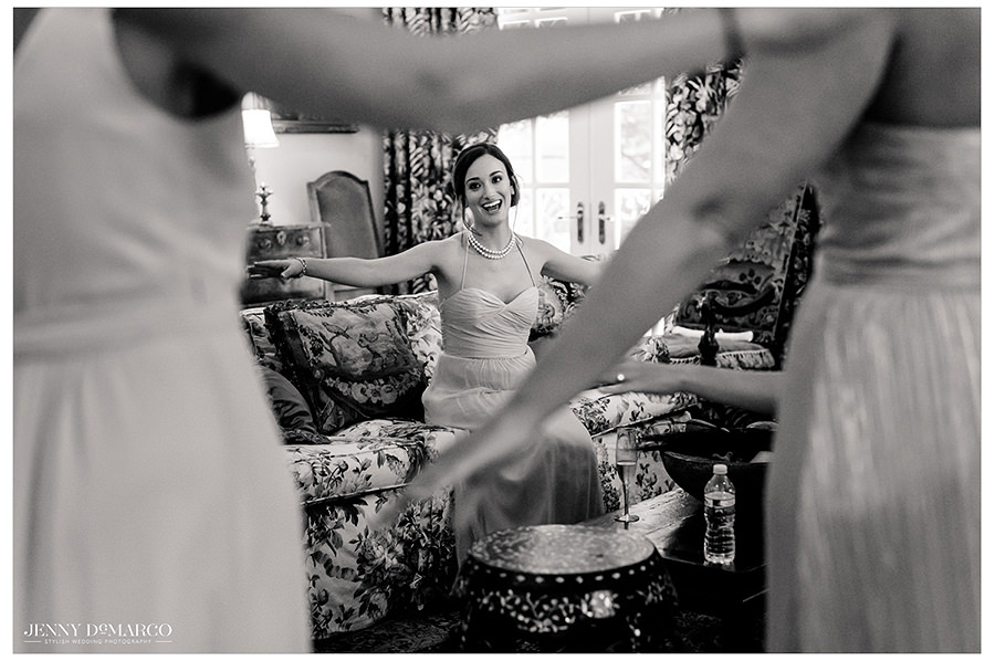 a beautiful black and white shot of the bridesmaids awaiting to see their friend