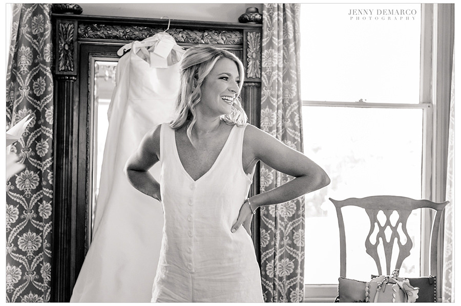 the stunning bride poses before she gets into her one of a kind gown