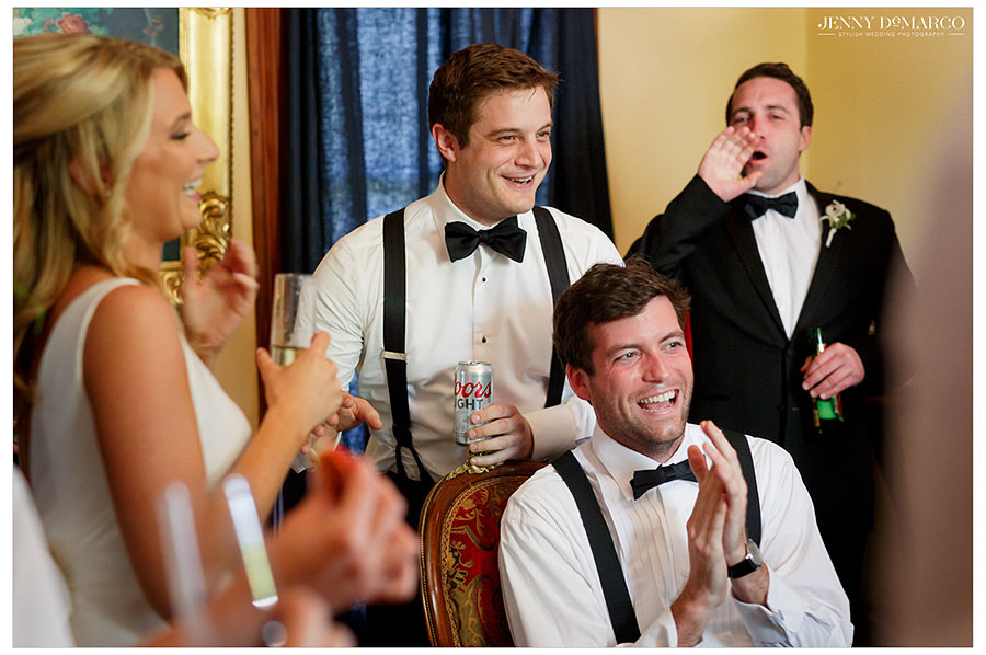 the wedding party cheers in excitement for the wedding