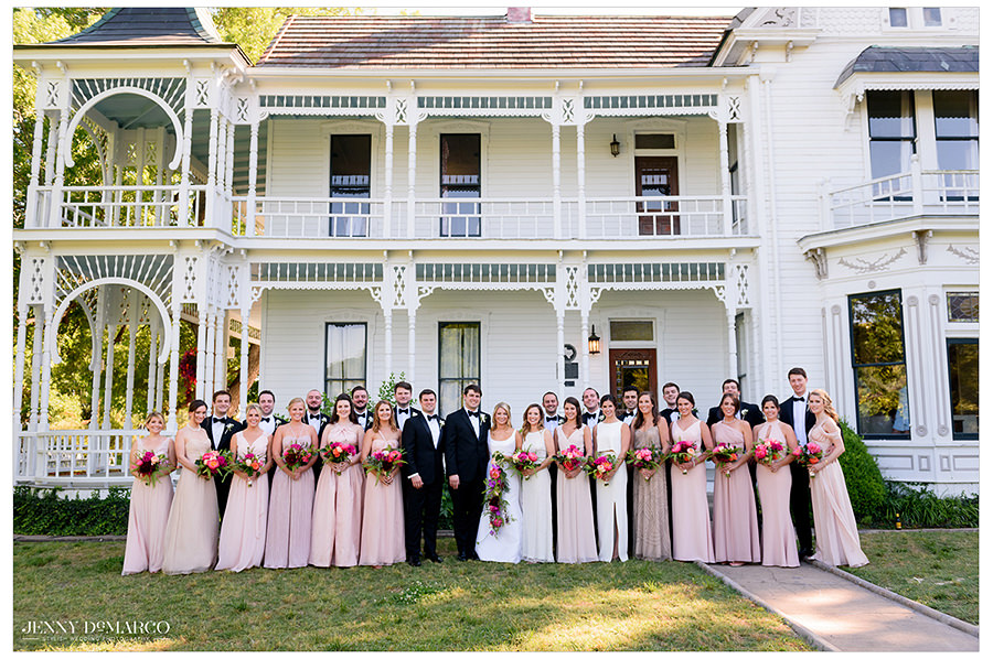 a colorful pre wedding shoot in front of the historic mansion