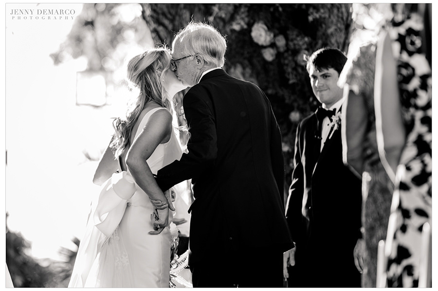 the father of the bride gives her away