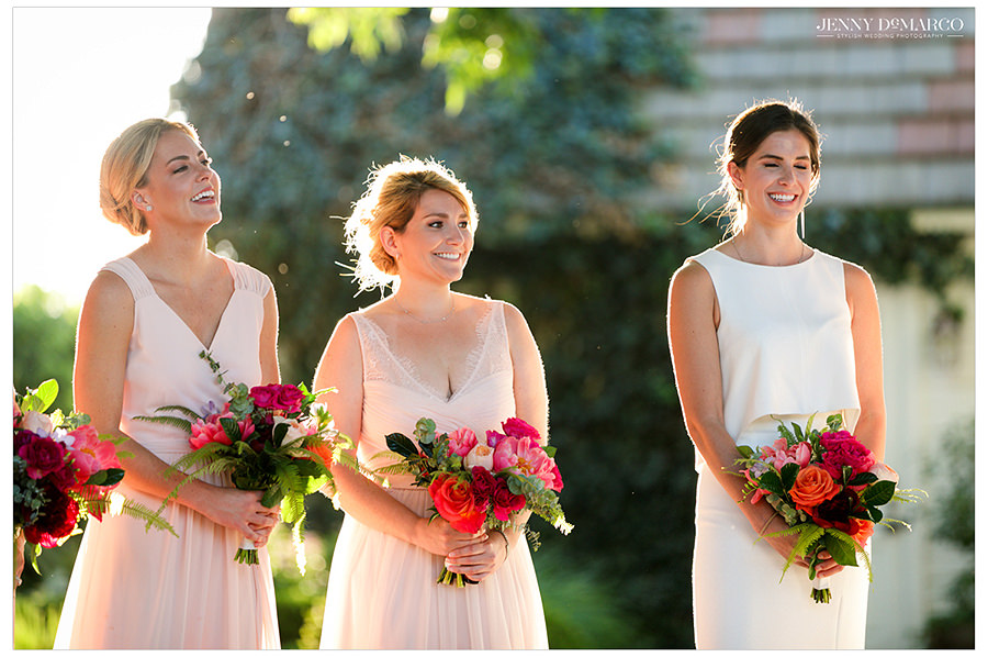 the bridesmaids watch their best friend marry the love of her life