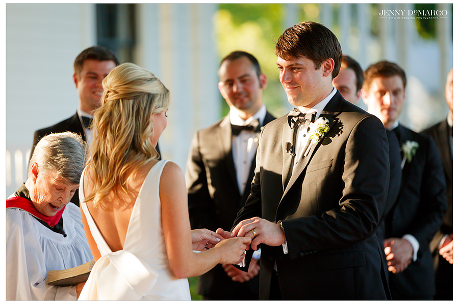 the bride and the groom share vows during the beautiful barr mansion ceremony