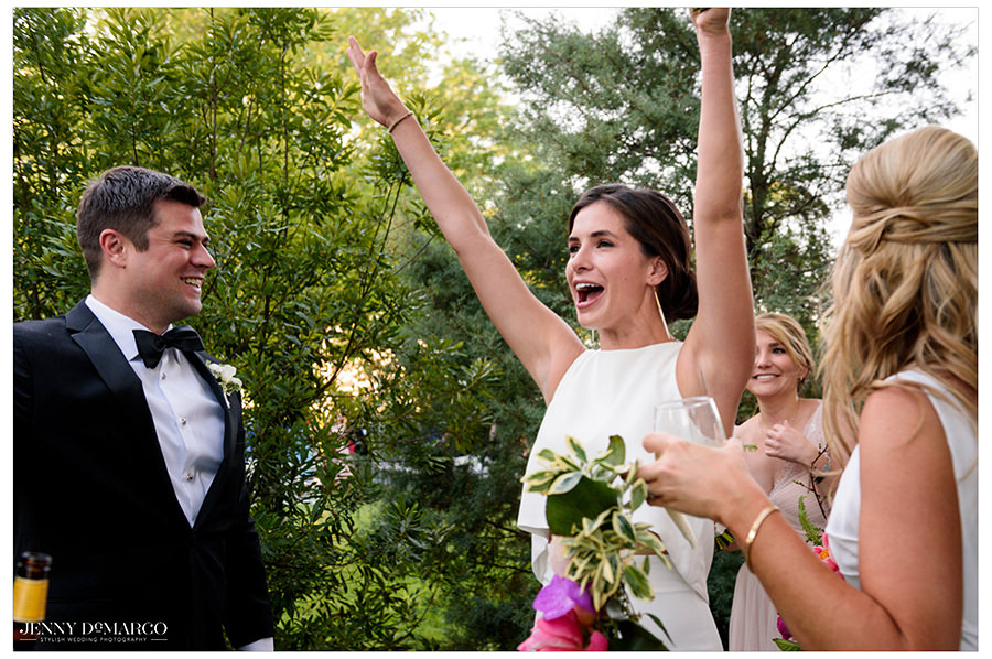 the maid of honor cheers on the happy couple
