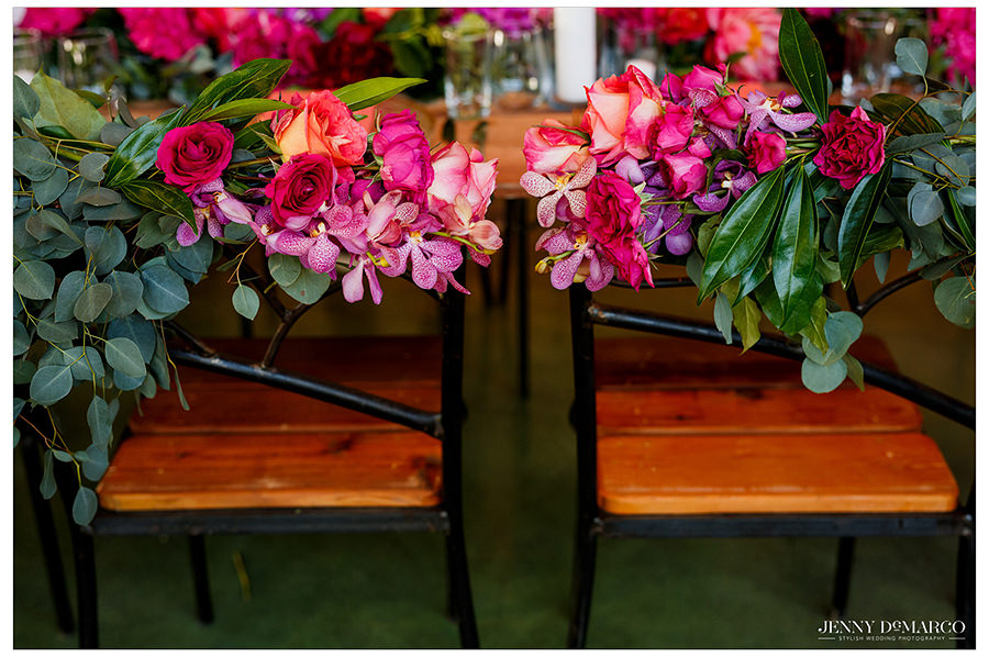 the seats of the wedding party covered with beautiful flowers