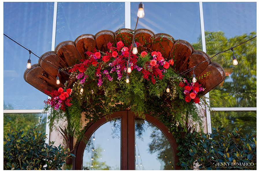 a beautiful bouquet if red and pink flowers cover the entrance